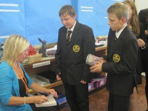 Yr 9s getting their books signed in Barnstaple